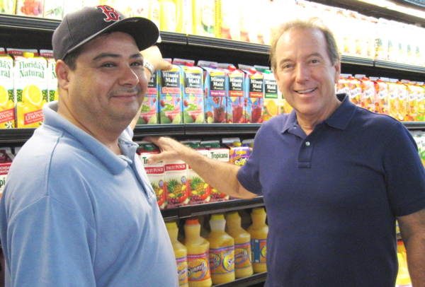 Manager Miguel Lopez, left, and owner Jim Overton in the St. John Gourmet Market.