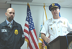 DEA agent Timothy T. Williams and V.I.Deputy Police Chief Christopher Howell at Friday's press conference.