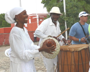 Dr. ChenziRa Davis Kahina and husband Carl Christopher play percussion near the Frederiksted pier.