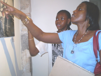 Gwen, right, and Javeysa Lake looking at art by Carmen Mojica.