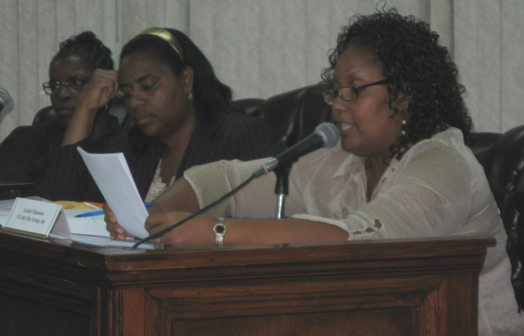 Unity Day Group President Lorelei Monsanto, right, makes a presentation to the PSC while members Stacie January, left, and Nydia Lewis listen.