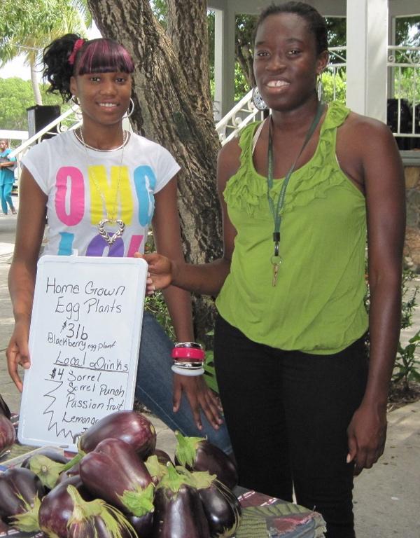 Shannika Isidore, left, and Kishma Riley sell eggplant.