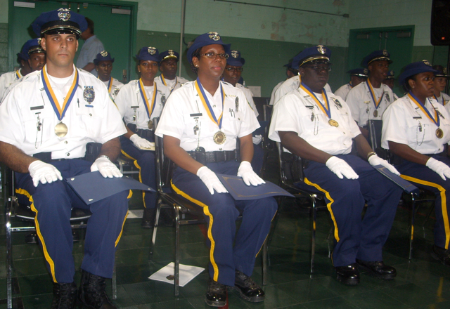 Police graduates sit straight and proud at the armory Friday.