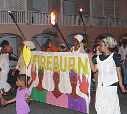 Crucians march in Frederiksted to mark the Fireburn revolt.