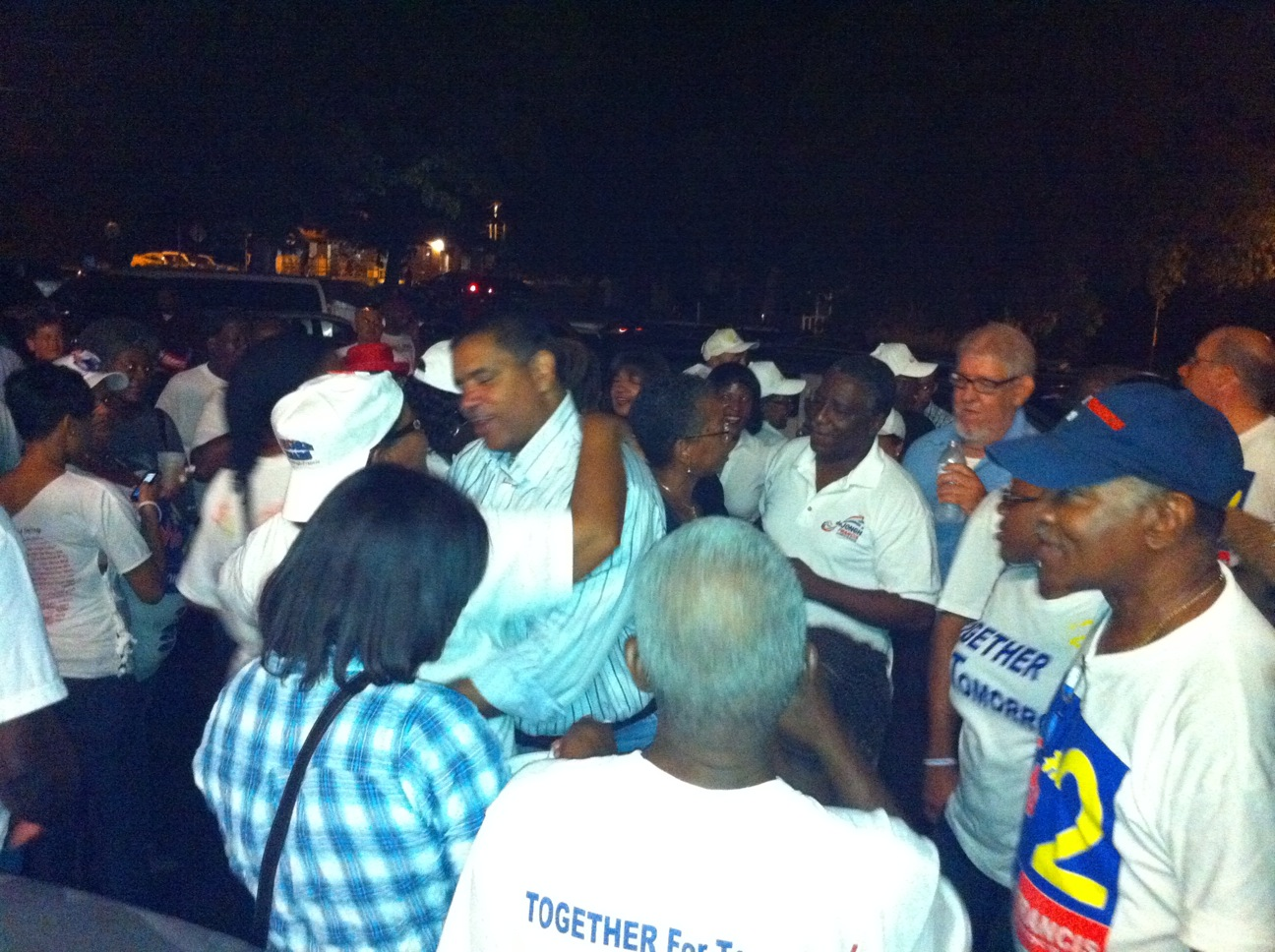 Gov. John deJongh Jr. and Lt. Gov. Gregory R. Francis celebrate winning the 2010 primary with supporters on St. Croix.