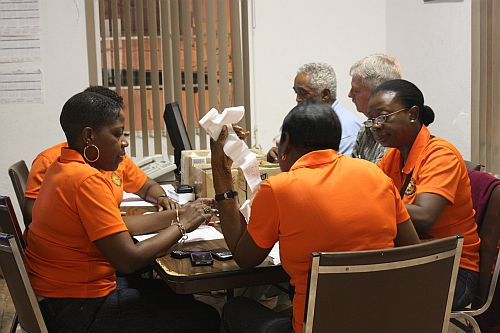 Board of Elections officials tally the results from Saturday's primary.