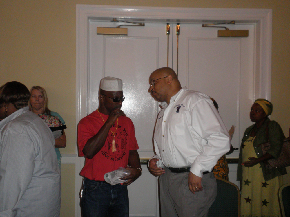 Raymond Smith (left) talks with Principal Baruti Kafele.