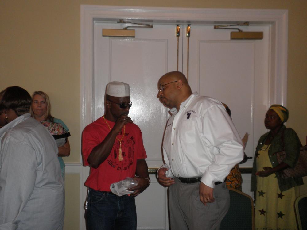 Raymond Smith (left) talks with Principal Baruti Kafele.