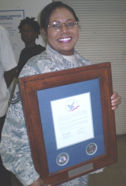 Master Sgt. Pamela S. Depusoir beams with pride after getting her letter.
