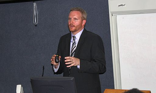Energy expert Adam Warren talks to conference participants about the V.I.'s energy roadmap.