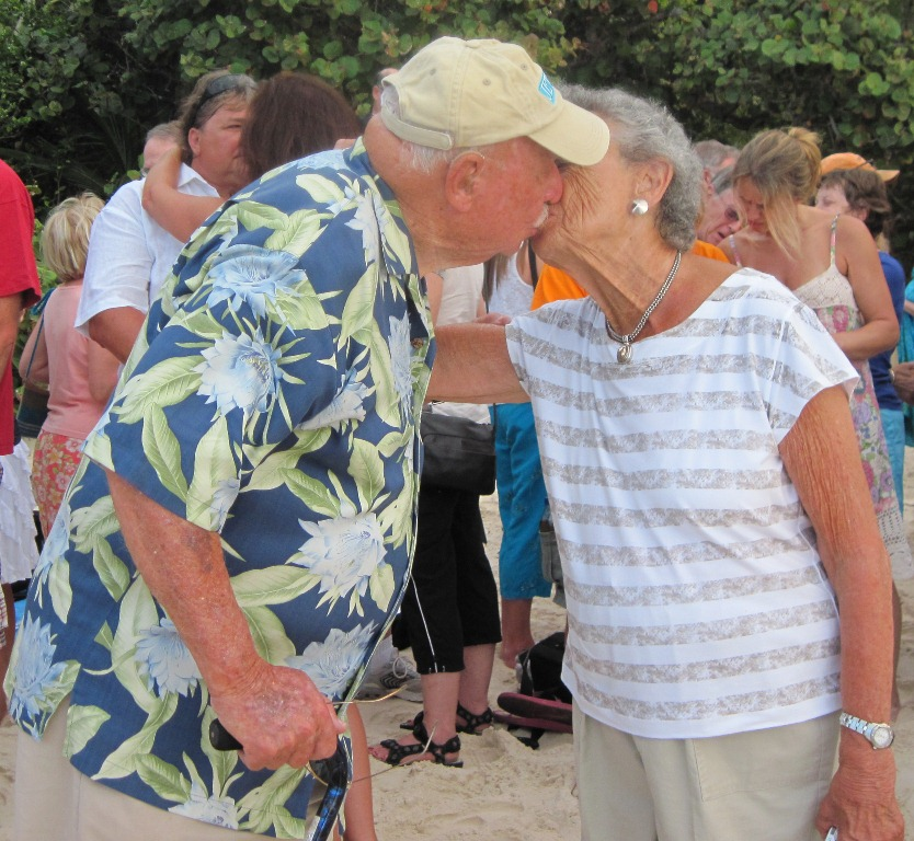 Howard and Jackie Levine punctuate their 'I Dos' with a kiss Monday at Trunk Bay.