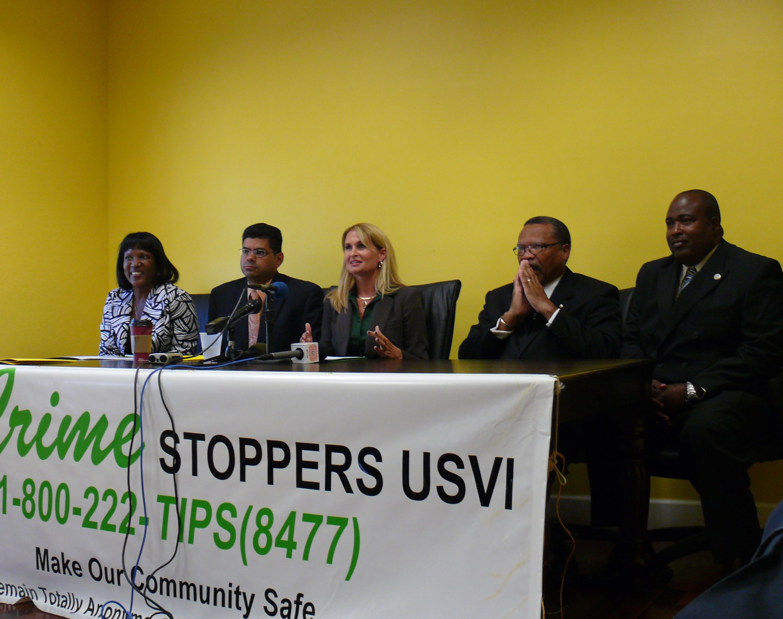 Crime Stoppers USVI's Judith Fricks (center) pointed to a long list of achievements during Tuesday's press conference.