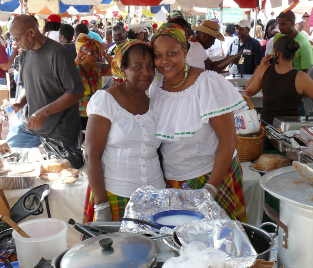 Elsa Clay and Dianna Arthurton of Frederiksted sell their wares to the throngs at the Food Arts and Crafts Fair Wednesday .