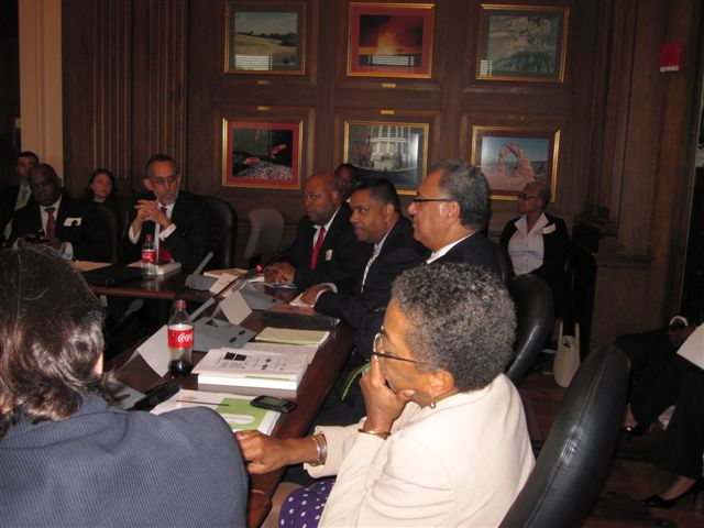 Delegate Christensen (foreground) and Gov. deJongh (center) meet with federal officials over a possible regional electrical grid.