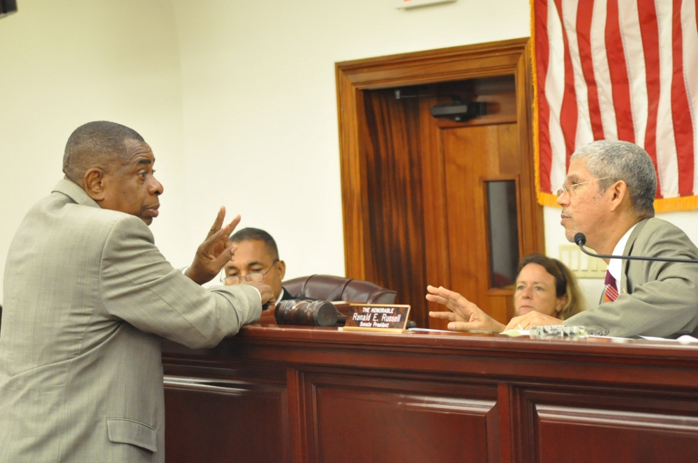 Senate Majority Leader Celestino White and Senate President Ronald Russell confer during Tuesday's session.