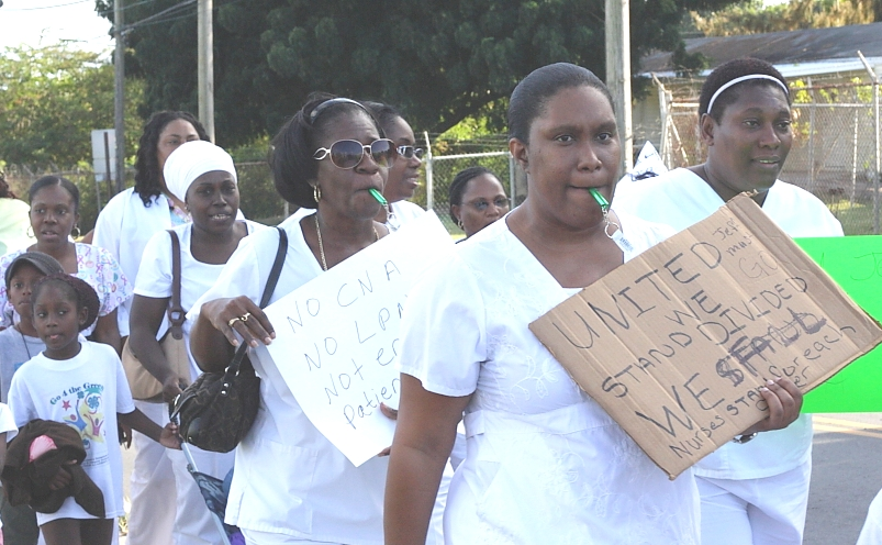 More than 100 nurses protested the recent layoffs at Juan F. Luis Hospital Thursday (Photo by Justin Shatwell).
