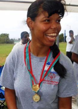 Chrystil Harper celebrates after winning a medal in the 25-meter run.