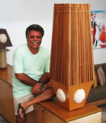 George Hollander with one of his handcrafted light fixtures.