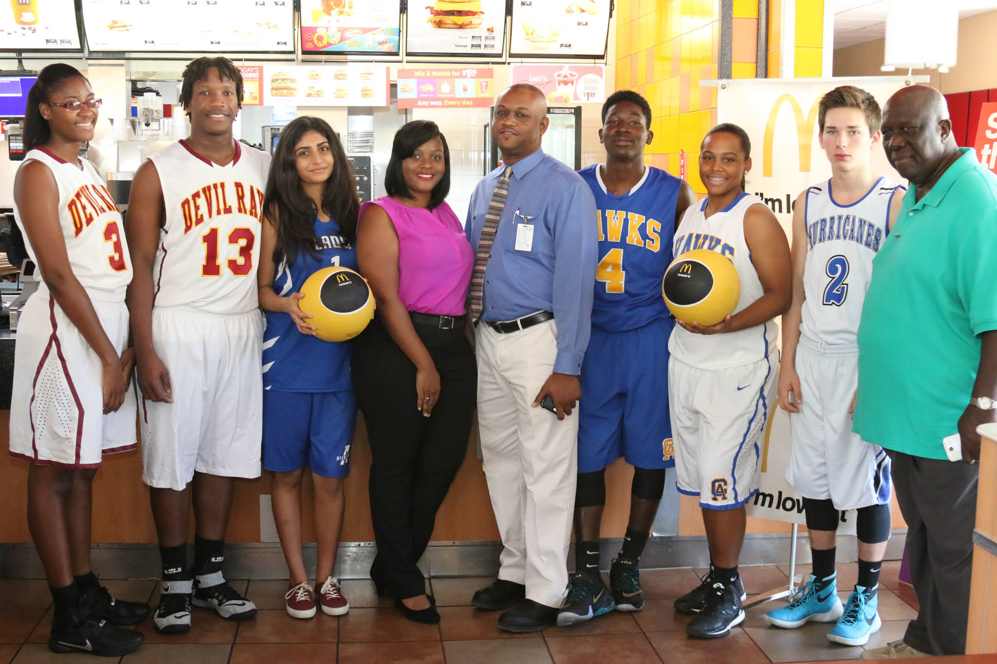 (From left) Haleema Francis and DeQuan Solis of Ivanna Eudora Kean; Mansi Totwani of Antilles School; Alithia Hodge, McDonald's operations supervisor; Mark Daniel of the DOE; Robelto James and Rhea Benjamin of CAHS; Ethan Lysiak of Antilles School; Buddy Kennings, commissioner of the Interscholastic Athletics Association.