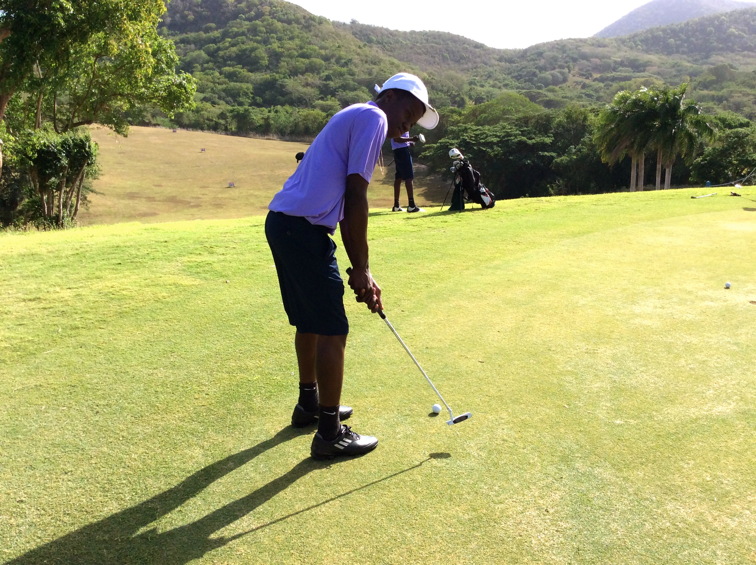 Keshawn Peets golfing at the Caribbean Golf Association Junior Championships