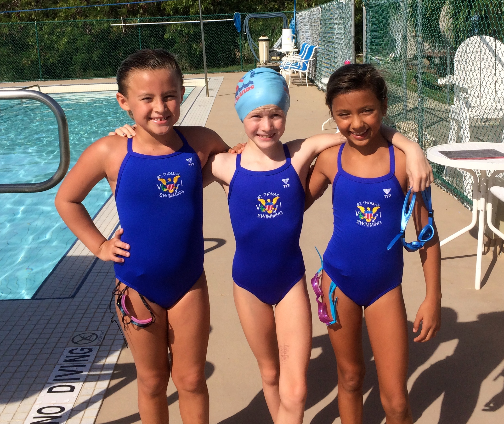 STSA Stingrays Sasha Poe, Fion Hughes and Khalia Moore are accomplished competitive swimmers in the 10 and under group. (photo by Kelly Moore)