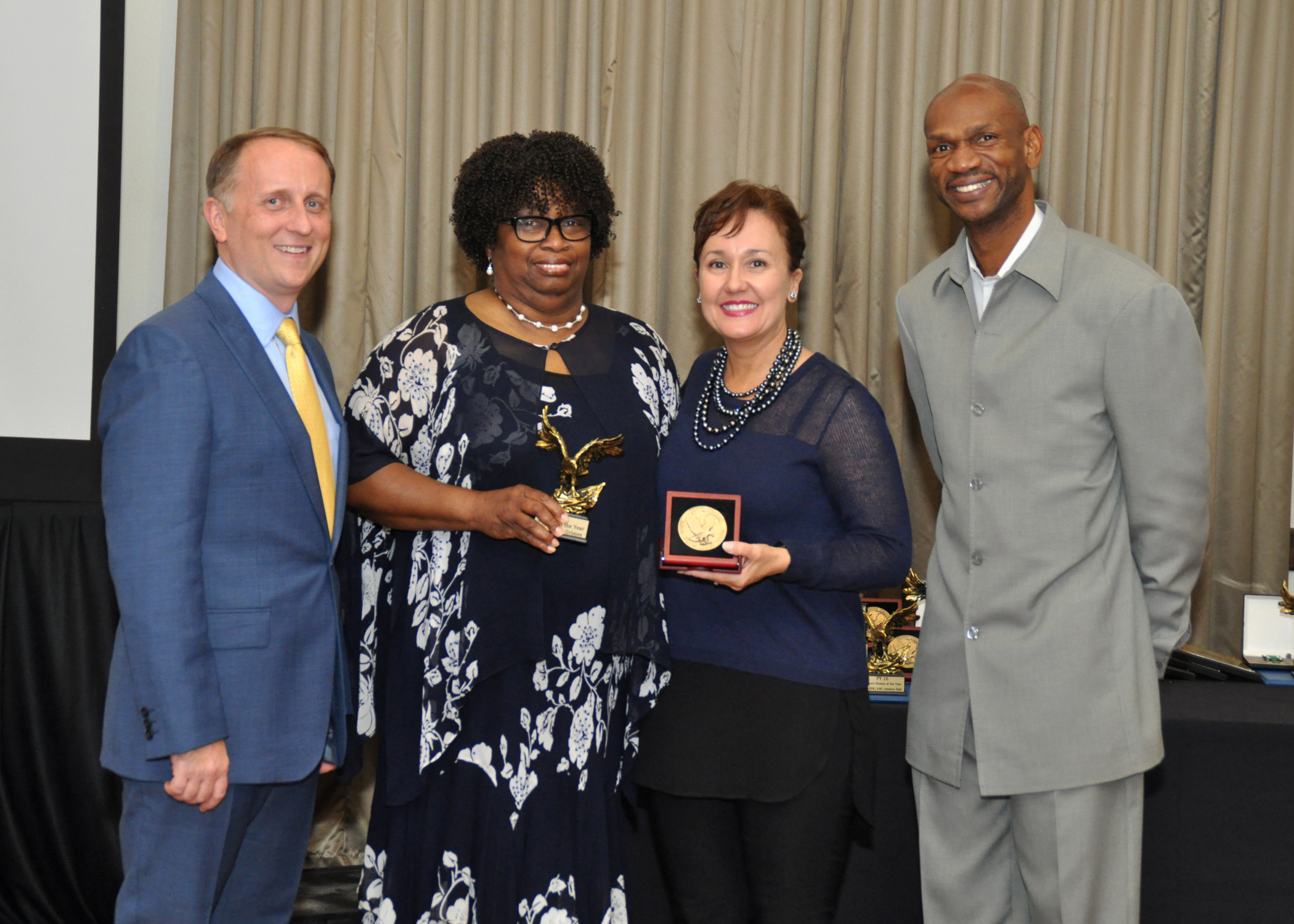 St. Thomas native Mariel Grimes (second from left), an enlisted processing assistant assigned to Navy Recruiting District (NRD) San Antonio, was recognized as the NRD's Civilian of the Year for Fiscal Year 2016 during an awards banquet held in Texas  (U.S. Navy photo by Burrell Parmer, Navy Recruiting District San Antonio Public Affairs/Released)