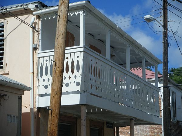 One of the group's projects was to renovate the balcony of this building, adding custom-made gingerbread railings and trim.