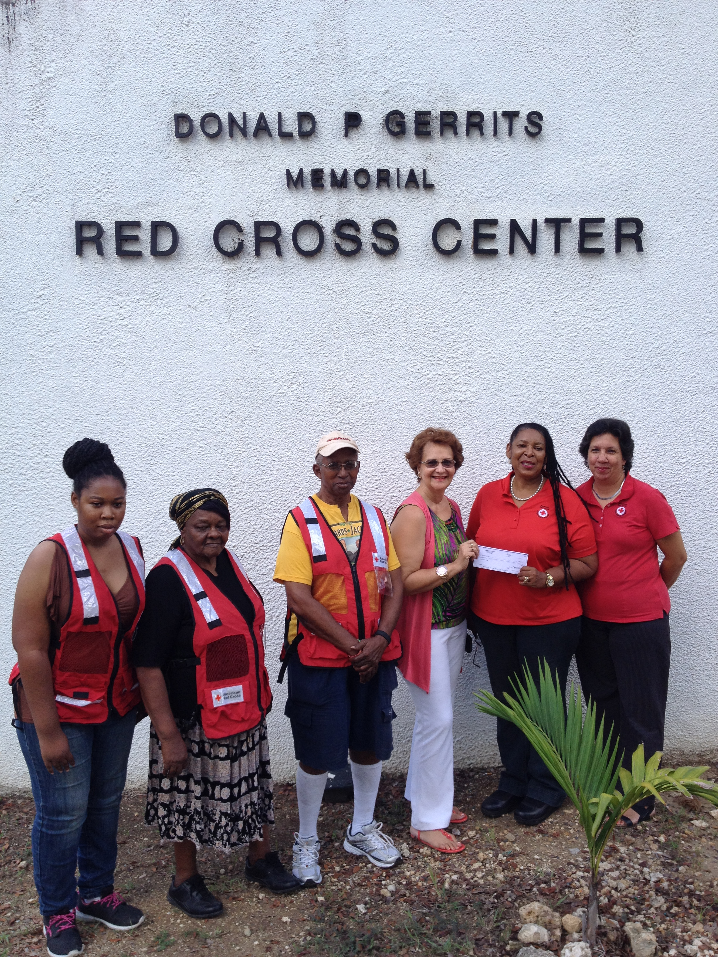 Caribbean Reservations Inc. donates check to American Red Cross V.I. staff
