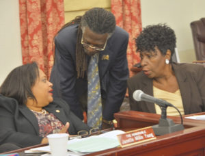 Sens. Janette Millin Young, left, Positive Nelson and Alicia 'Chucky' Hansen confer during Tuesday's session. (Photo by Barry Leerdam, provided by the V.I. Legislature)