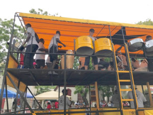 Steel pan orchestras got the music going with festive tunes.