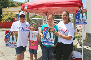 Janelle Sarauw supporters campaign outside the Charlotte Amalie High School Saturday morning.