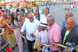 Gov. Kenneth Mapp, Lieutenant Governor Osbert Potter, Village honoree Juan Harrigan and members of this year's Carnival court officially open the Carnival Village Friday night.