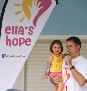 Shaine Gaspard hold his daughter Ella at the first annual 5K walk/run to raise funds to cure Rett syndrome.
