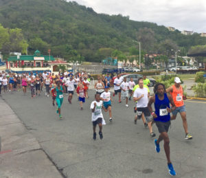 Runners take off from the starting line in Havensight mall on St. Thomas.