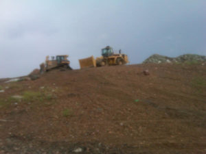 A9 Trucking working on one of the two V.I. landfills