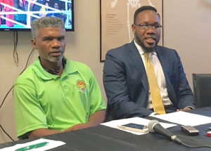 Julian Jackson Sr. and Clayton Laurent Jr. announce Laurent's new management contract.