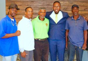 From left, Julian Jackson Jr., Susthens 'Joey' Vialet, Julian Jackson Sr., Clayton Laurent Jr., and David Rogers Sr.