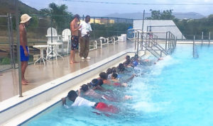 Boys and Girls Club members learn to swim, a prerequisite for the Marine Vocational Program. (Photo by Jimmy Loveland.)