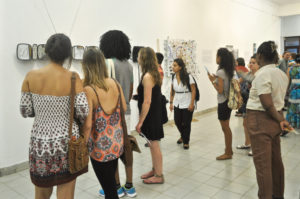 Exhibition goers enjoy works by V.I. contemporary artists.