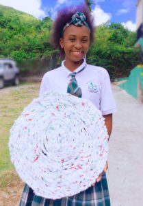 Student members of Island Glory Crafts, a Junior Achievement company, turn plastic shopping bags into braided mats. (Submitted photo)