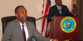 At a Friday news conference, Attorney General Claude Walker, and Lieutenant Governor Osbert Potter discuss how they will safeguard upcoming property tax auctions against fraud.