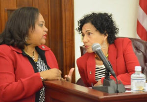 Sens. Janette Millin Young and Nereida Rivera-O'Reilly at Wednesday's session (photo by Barry Leerdam courtesy of the V.I. Legislature)