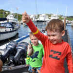 Four year Eli Hume shows off his catch while 2-year-old brother, Wyatt, looks on