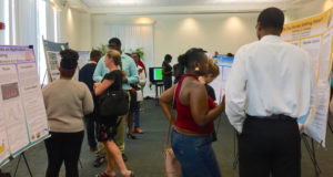 Several dozen people attended the annual Summer Student Research Symposium at UVI on St. Thomas to learn about the students' projects.