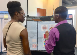 Photo caption 2: Student Peter Jean-Baptiste tells professor Verleen McSween about his project on 3D magnetic reconnection.