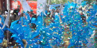 The Westin's troupe, carrying signs celebrated the resort's 20th year on St. John, blew a blizzard of confetti into the air.