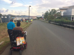 Getting around St. Thomas is difficult for Javanka Larcheveaux on her motorized wheelchair, since sidewalks are lacking and streets are unmarked.