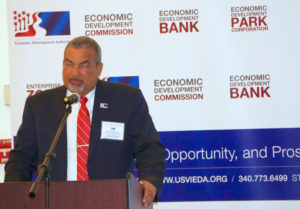 Wayne Biggs Jr., head of the EDC, addresses the business summit Tuesday.
