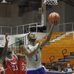 Dukes guard Matt Lewis scores two of his 16 points against the Ravens.