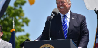 President Donald Trump addresses a crowd.